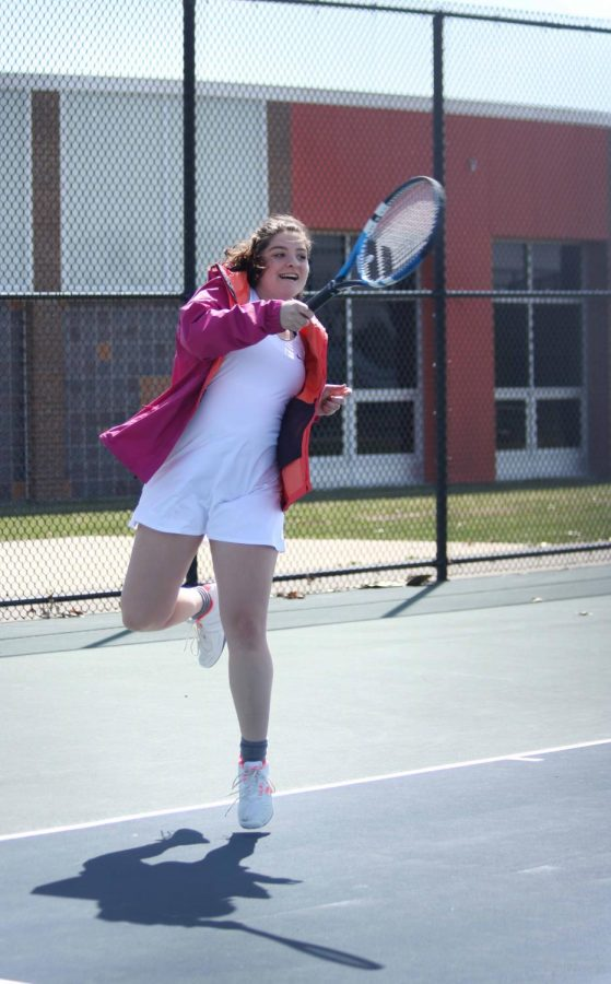 Senior Leah Krantz hits the tennis balll back to her Holly opponent. The varsity tennis players have another game on April 27 against Ortonville-Brandon.