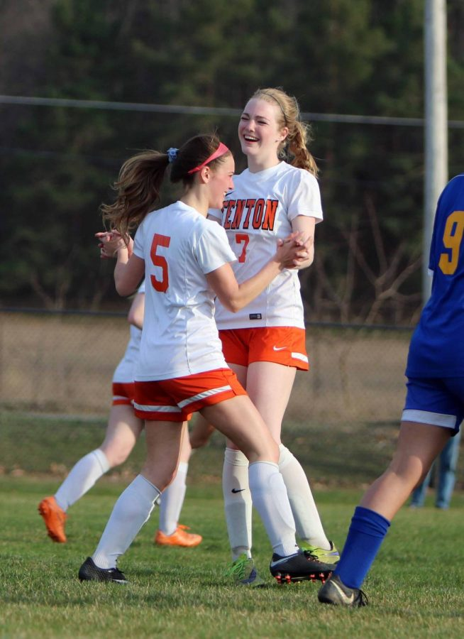 Senior Hayley Clarke and junior Lauren Murphy celebrate after Clarke's goal off a corner kick. The girls played Kearsley on Monday, April 23 at 6pm.