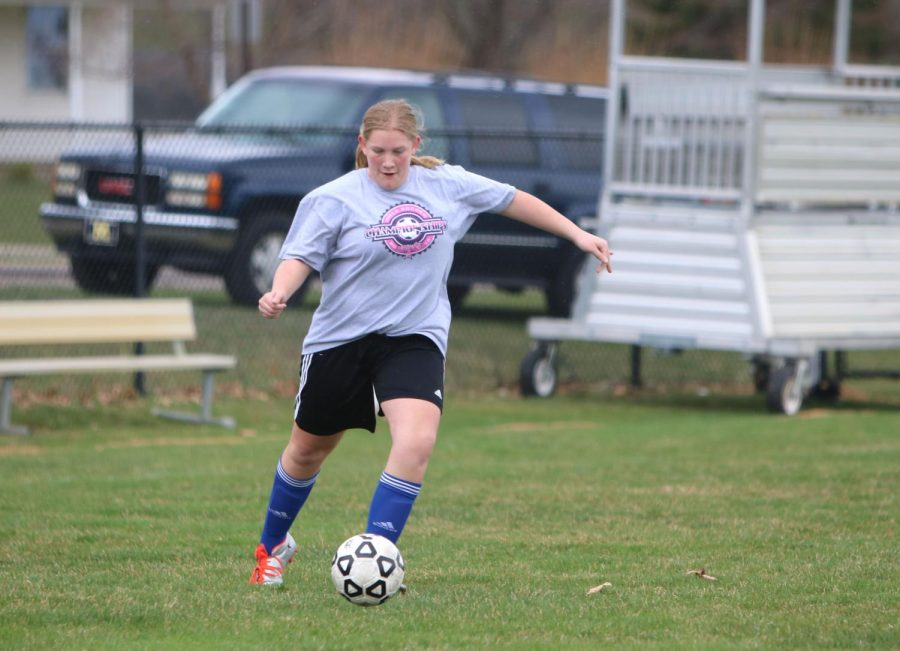 Freshman Jillian McVey practices dribbling and passing with fellow teammates on Apr. 24. The j.v. girls soccer team practiced with the varsity girls soccer team to prepare for their upcoming games.