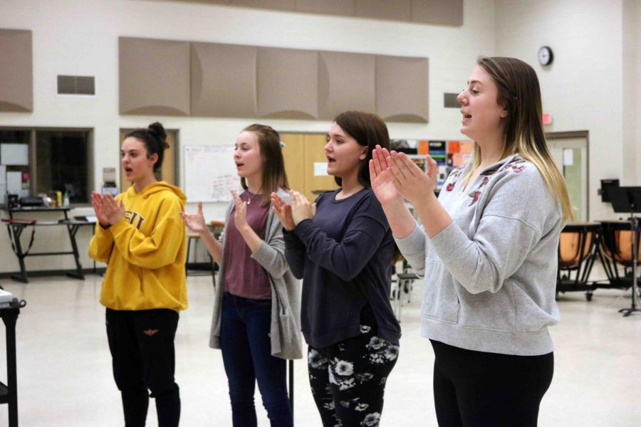 Sophomores Autumn Decker, Addy Taylor, Megan Beemer, and Regina Pauly practice the call to attention and parade rest for their Drum Major auditions. It was announced that sophomore Cray Dumeah is going to be the junior Drum major for the 2018-19 Marching Band season.