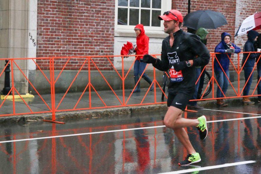 Despite the rain, Jesse Anderson takes 20th overall in the Boston Marathon.