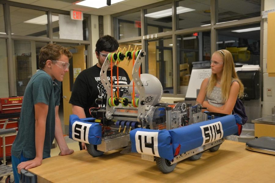 Members of the robotics team Breanna Trecha and Connor Mead prepare their robot for the upcoming competition.