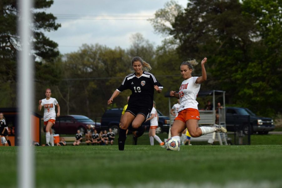 Kicking the ball, Senior Lucy Foguth helps her tam secure the Metro League title. Fenton beat Flushing 4-2
