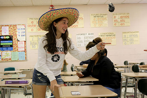 Singing a song to her classmates, sophomore Lauren Bossenberger takes part in her Cinco de Mayo party. The class brought in Spanish foods and celebrated the Mexican holiday.