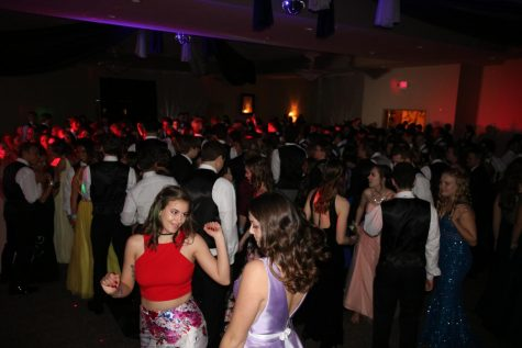 After finishing dinner, students gathered onto the dance floor.