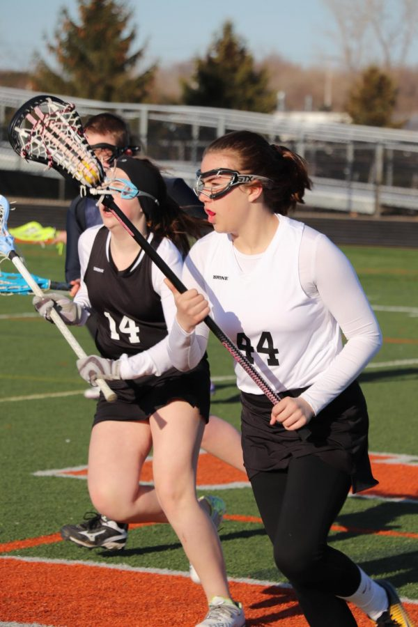 Getting the ball passed to her, freshman Emilee Guertin runs to the goal. The girls JV lacrosse team played Ovid on April 19.