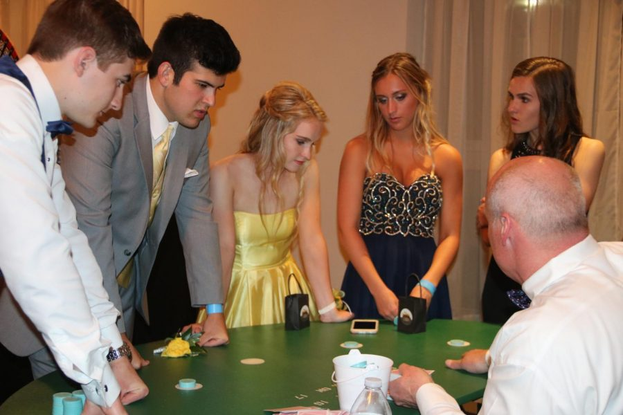 Concentrating on their game, junior Jackson Hancook, senior Tyler Macintosh and juniors Shelby Murphy, Payton Hurley and Makayla Murphy play a round of Blackjack.