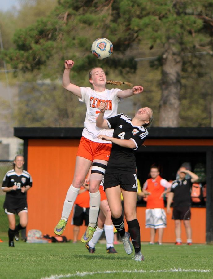 Junior Lauren Murphy jumps up to head the ball after a corner kick. The varsity girls soccer team played Flushing on May 14th at 6 pm, the girls won 4-2 securing their metro champs title.