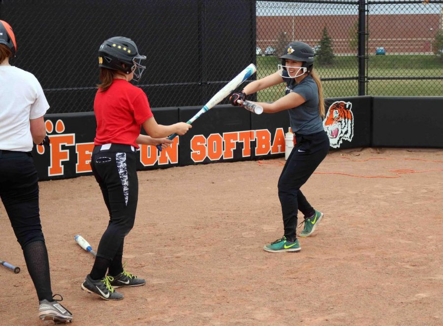 Freshman Hailey Blackwell and Ella Turnblom have fun with their bats at practice. The girls jv softball team is having a promising season so far.