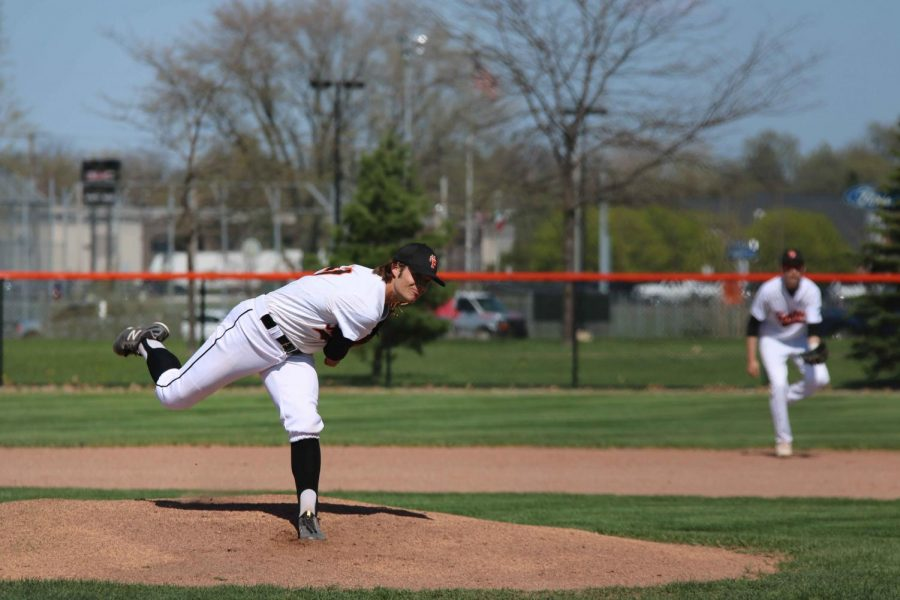 Junior Logan Welch pitches the ball during the varsity game on May 7. They played Kearsley and won 10-1.