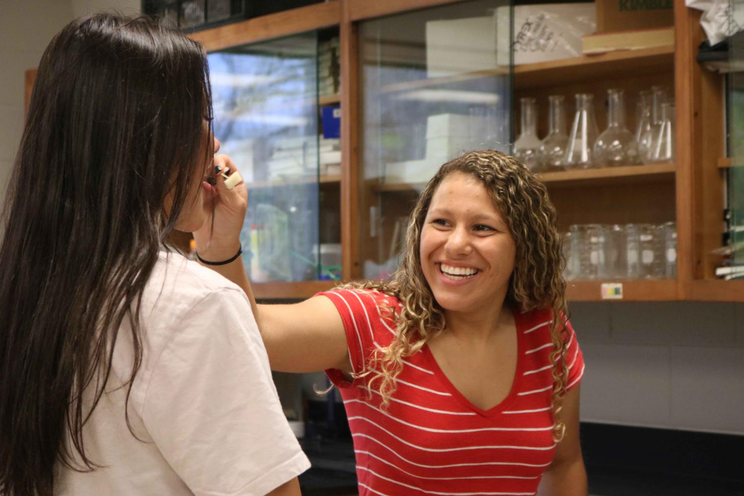 During an anatomy lab, juniors Kirsten Foor and Leaha Brackenridge test their ability to taste different foods without using their sense of smell. The lab had many different stations that were designed to teach students about their sense of smell and taste.