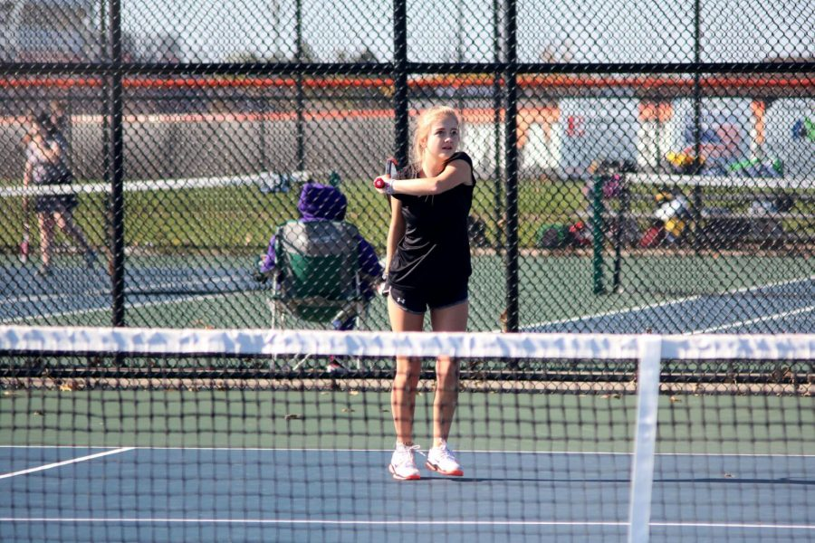 Sending the ball across the net, sophomore Avery Remillard swings through her hit. The JV girls tennis team played the Owosso Trojans.
