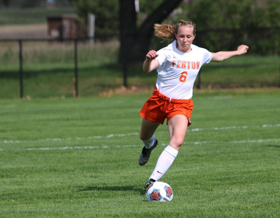 Freshman Mallory Lehmann prepares to kick the soccer ball to her teammate on May 14. The JV girls soccer team played Flushing and won the game 7-0.