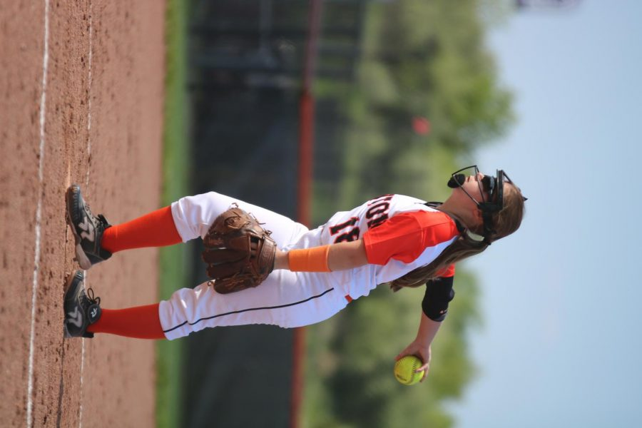 Pitching for the Fenton tigers, junior Angela Hanners participates in the varsity softball game against Davison on May 16. The girls won against with wit scores of 7-5 and 4-3.