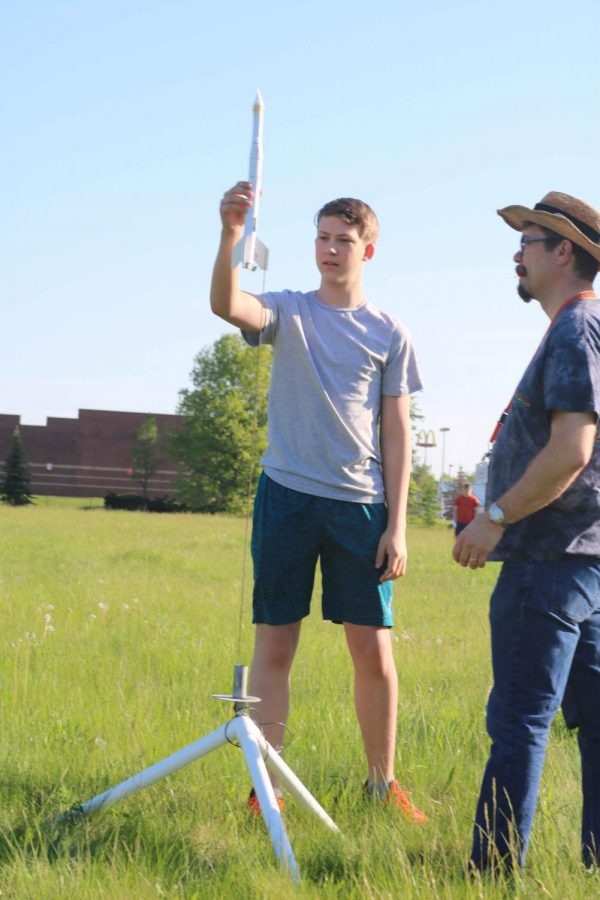 Freshman Cooper Partridge sets his rocket onto the