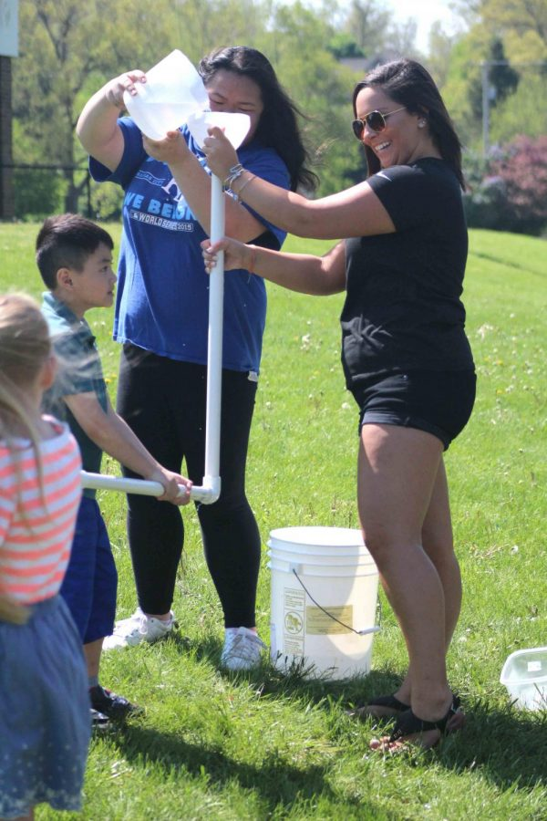 Senior Sam Conte works the water station with senior Vivian Huynh. During pond day first graders from State Road, North Road, and Tomek came to the high school to learn about the ecosystem.