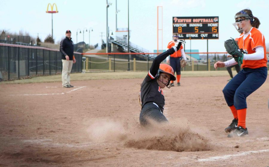 Sophomore Anna Weigle slides into home base and is called safe. The Junior Varsity softball team won in their game against Flint Powers Catholic on April 11.