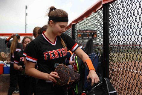 Sophomore Erica Behnfeldt packs her things after the girls JV softball team's game against Flushing. Behnfeldt was officially moved from the junior varsity team to the varsity team on May 1.