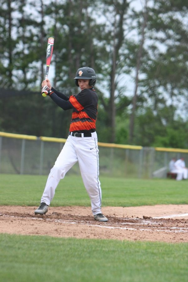 Senior Tommy Adams dodges a bad pitch or a 'ball' during the game against Milford on June 2. The varsity team lost 5-2.
