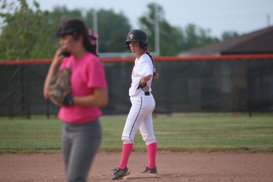 Focusing her eyes on the batter, junior Sara Eisenbeis gets ready to run to third base. The Fenton varsity girl softball played against Brandon and won 5-3.