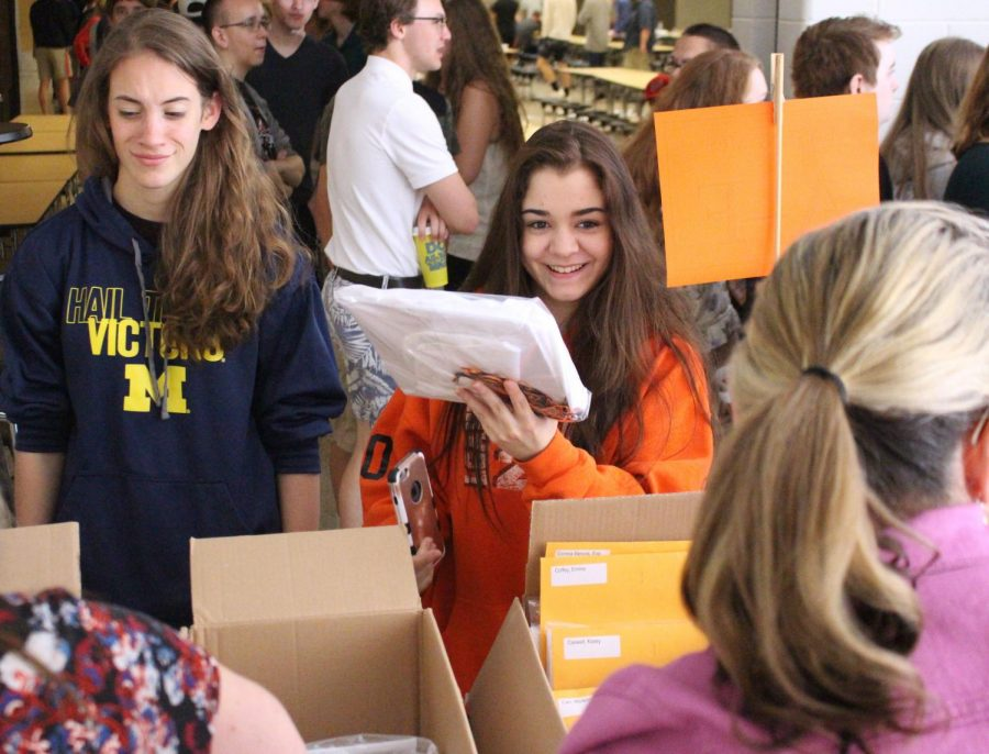 Senior Megan Aneq gets her cap and gown for graduation on June 6. Seniors went to the cap and gown pick up, and changed into their class shirts before the senior class meeting.
