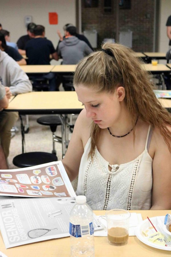 Graduate Olivia Blumemschein reads the senior issue of the Inprint at ther senior breakfast. The breakfast was on June 6 at 8 am in the cafeteria.