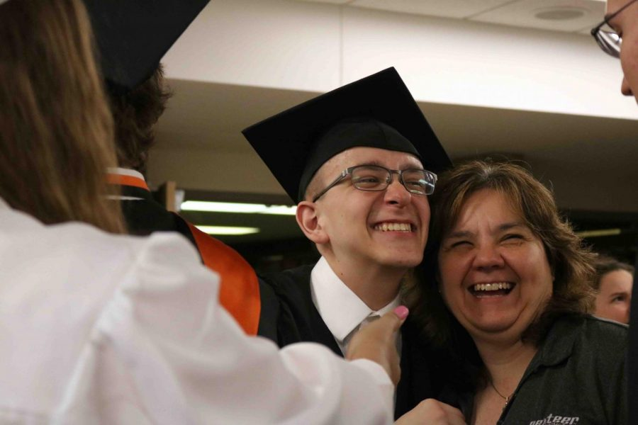 Graduate+Joe+Amberg+laughs+with+his+mom+at+the+Baccalaureate+Ceremony.+The+Ceremony+was+held+in+the+auditorium+on+June+7+at+7pm.