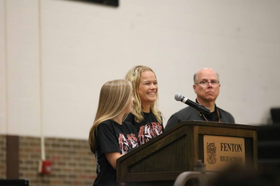 Seniors Lucy Foguth and Riley Shegos announce the Baccalaureate Ceremony time during Graduation Practice on June 6. All seniors attended Graduation Practice in order to understand how the official ceremony works.