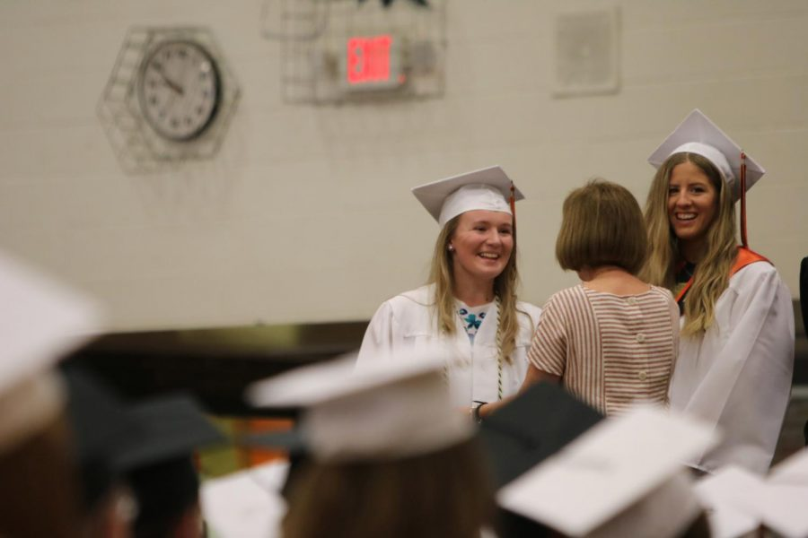 Seniors Maya Mead and McKenzie Lookebill accept their awards at the Senior Honors Assembly on June 8. Yearbook and Newspaper adviser Pam Bunka presented them with awards related to their success in journalism.