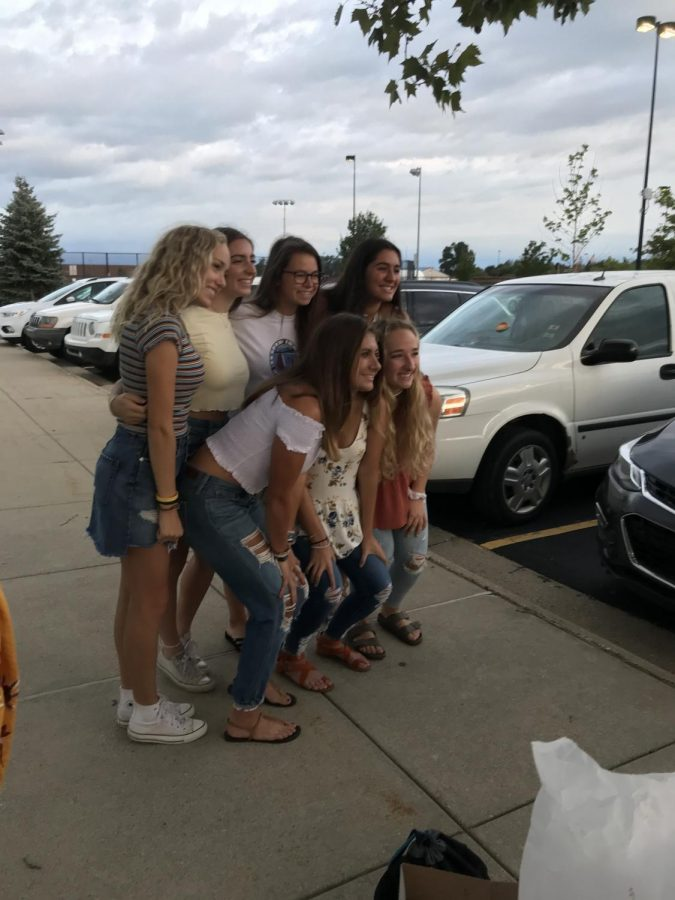 Starting off their first day,  seniors Abbey Lee, Cami Tiemann, Rachel Smith, Lauren Lamb, Delaney Miesch, Julia Stocker and Drew Follett take a picture. The seniors had a picnic breakfast to start off their final year.