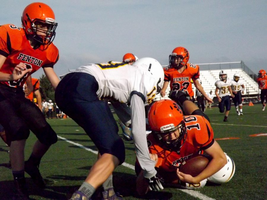 Fenton freshman football is winning against Bendle at home. Freshman RJ Homing takes the ball and gets tackled at the winning game.