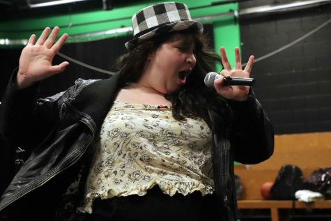 Singing along to Shania Twain, senior Hannah-Marie McDowell performs a skit for her drama class.  The IB Theater class recreated iconic 1990s music videos for their classmates.