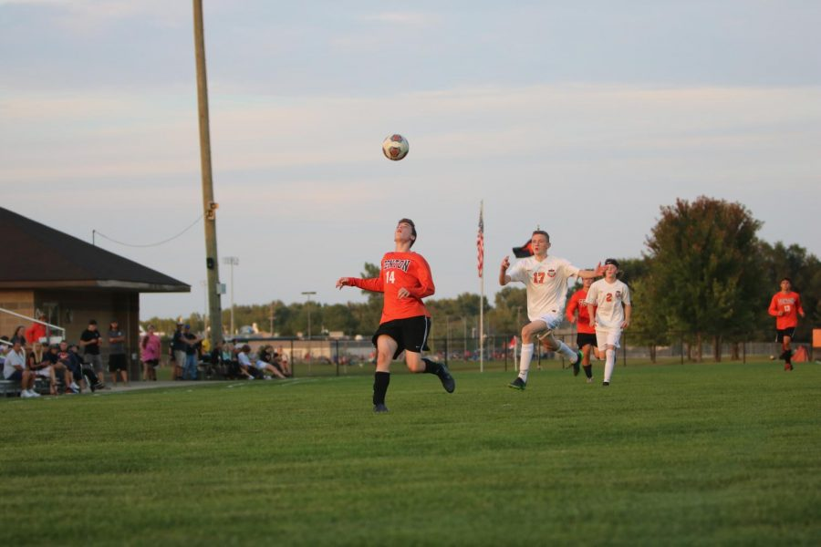 Watching the ball in the air, sophomore Ashton Mckellar gets ready to head the ball. The boys varsity soccer team played against Clio on Sept. 19.