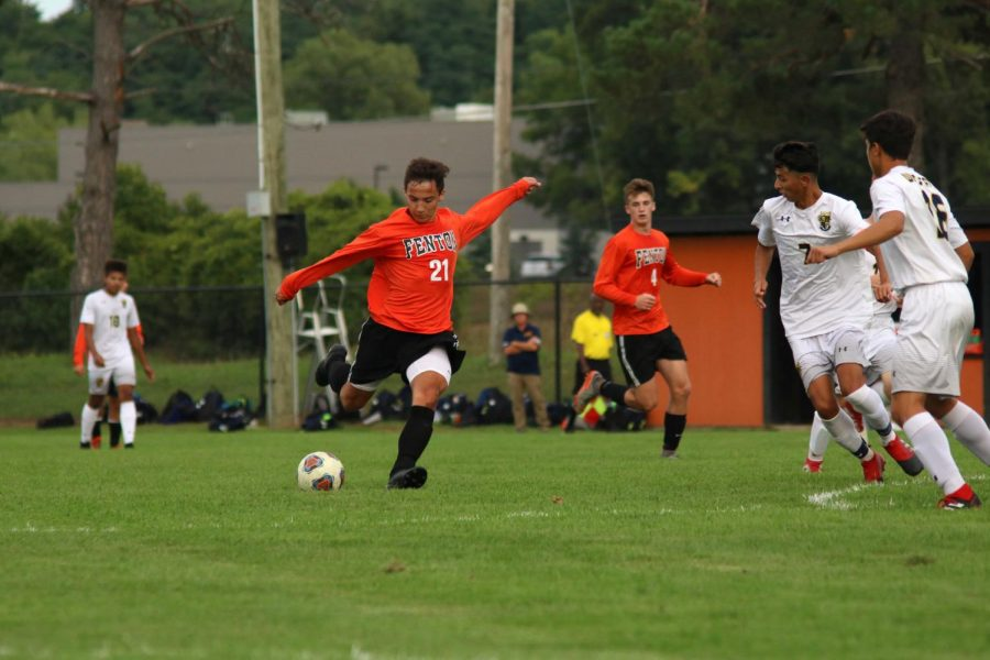 During the varsity boys soccer game, junior Alex Flannery prepares to kick the ball toward the goal. The varsity soccer players won their game against Oxford on Sept. 6, 2-1.