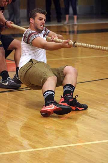 At the homecoming pep assembly, senior Keegan Jarrett pulls the rope towards his team. The seniors won tug of war at the assembly.