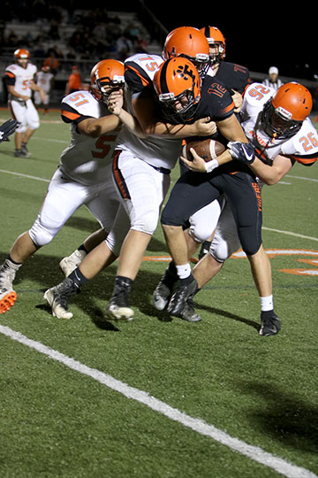 As he pushes against the defense, junior Lucas Clayborn attempts to get a first down. The Fenton Tigers played the Clio Mustangs in the 2018 homecoming game.