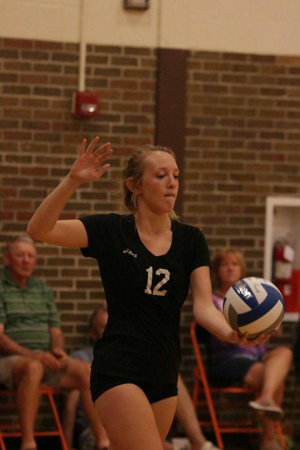 Preparing to serve, freshman Maia Taubitz begins the play for Fenton.  The girls beat Brandon on Sept. 6.