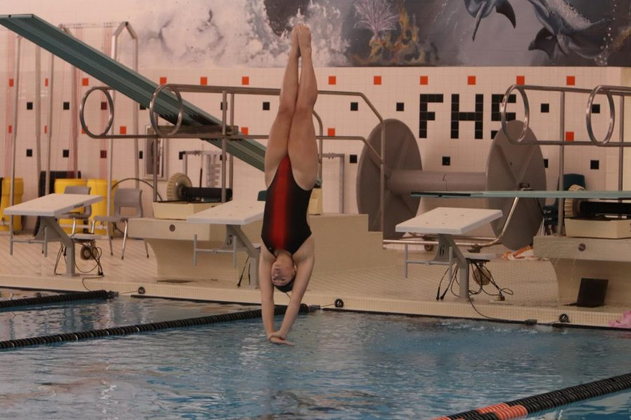 The smell of chlorine, the sound of splashing and the dead silence before the dive. sophomore Emma jump makes her hands and feet line up to make the perfect dive.