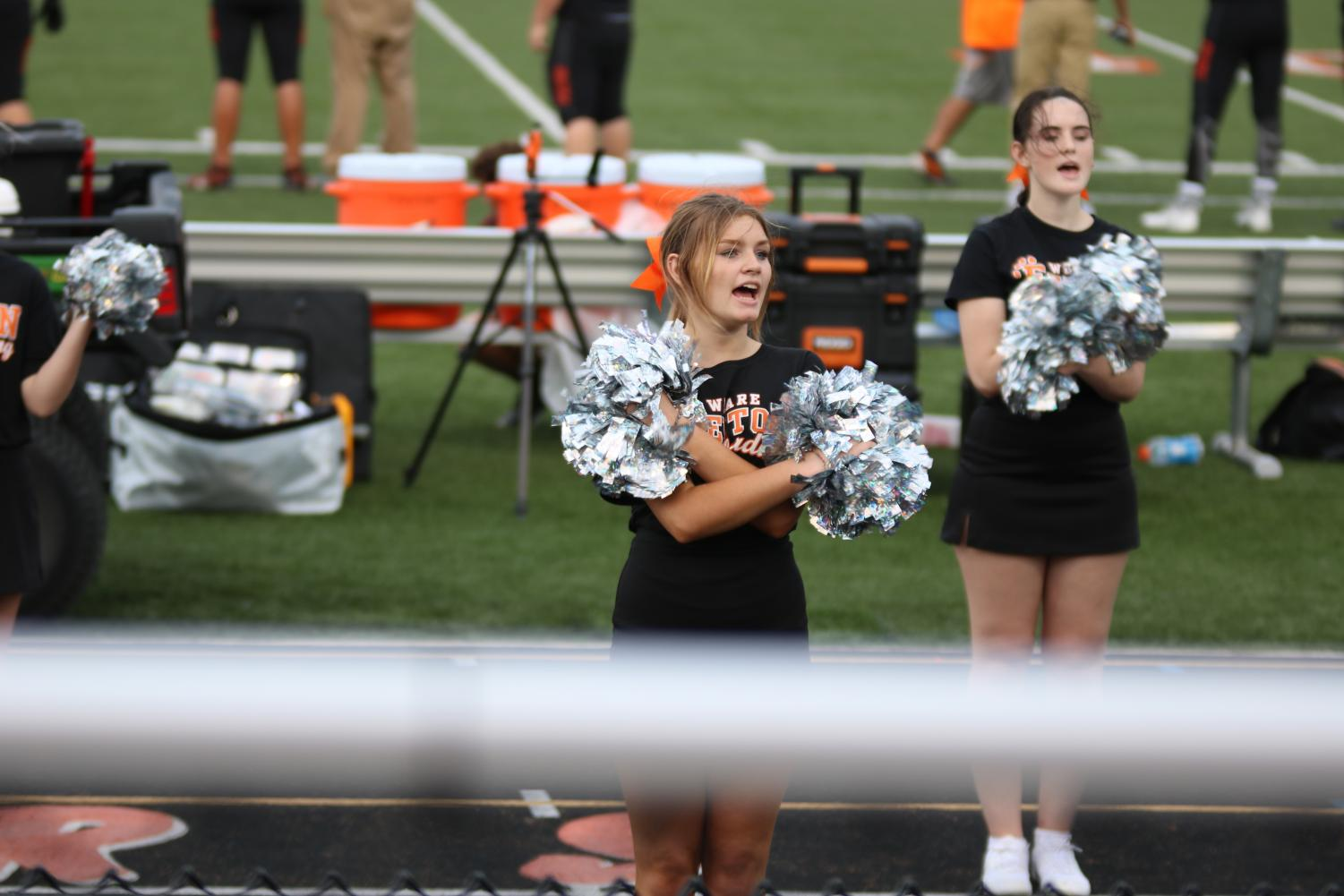 Cheering for the Fenton JV Football team during their first home game, Sophomore Briana Bennett cheers on the defense as they faced their opponent: Kearlsey's JV Football team. The team won against Kearsley on a hot August night, making them 1-1.