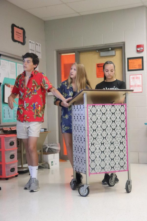 During the week of homecoming, freshman Sam Claborn, Jessica Dunkal and Maddy star, have a presentation for World History, as they are dressed in spirit wear. This day of spirit week was tacky tourist day.