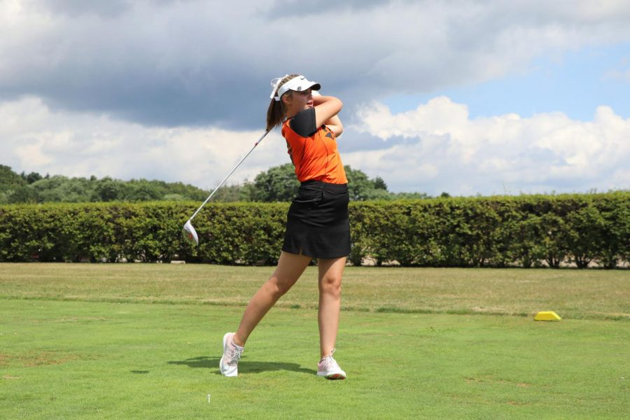 Starting off the match, senior Ava Stebbins makes her first shot of the tournament on April 21. The girls varsity golf team played and won their match against Brandon at Tyrone Hills.