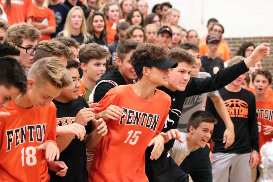Waiting for their shot at the battle cry , the sophomore class hold their breath. Later the sophomores won the battle cry against the rest of the school.