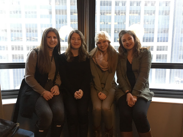 Graduates McKenzie Lookebill, Riley Wilson and Tess DeGayner and junior Gracie Warda pose in front of the New York City skyline. Members of the InPrint staff visited NYC to receive a Silver Crown Award for the 2015-2016 school year.