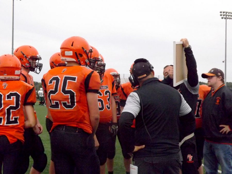 Quickly, the Fenton Freshman Football team think of a strategy to take back the game. Coach Jeff Adams laid down the new game plan and the team tried their hardest, but received their first loss this season.