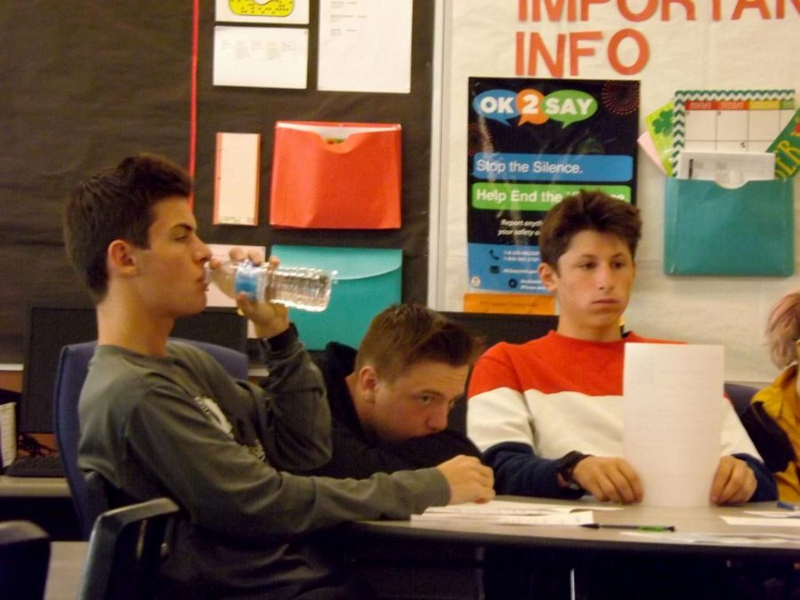 During Career Day, sophomores Gage Bond, Wyatt Haiss and Hunter Wheeler listen as the presenters talk about their jobs and answer questions. Pam Bunka's SRT class listened to a gym owner, ICU nurse at a University of Michigan hospital and a PICU nurse at another University of Michigan hospital.