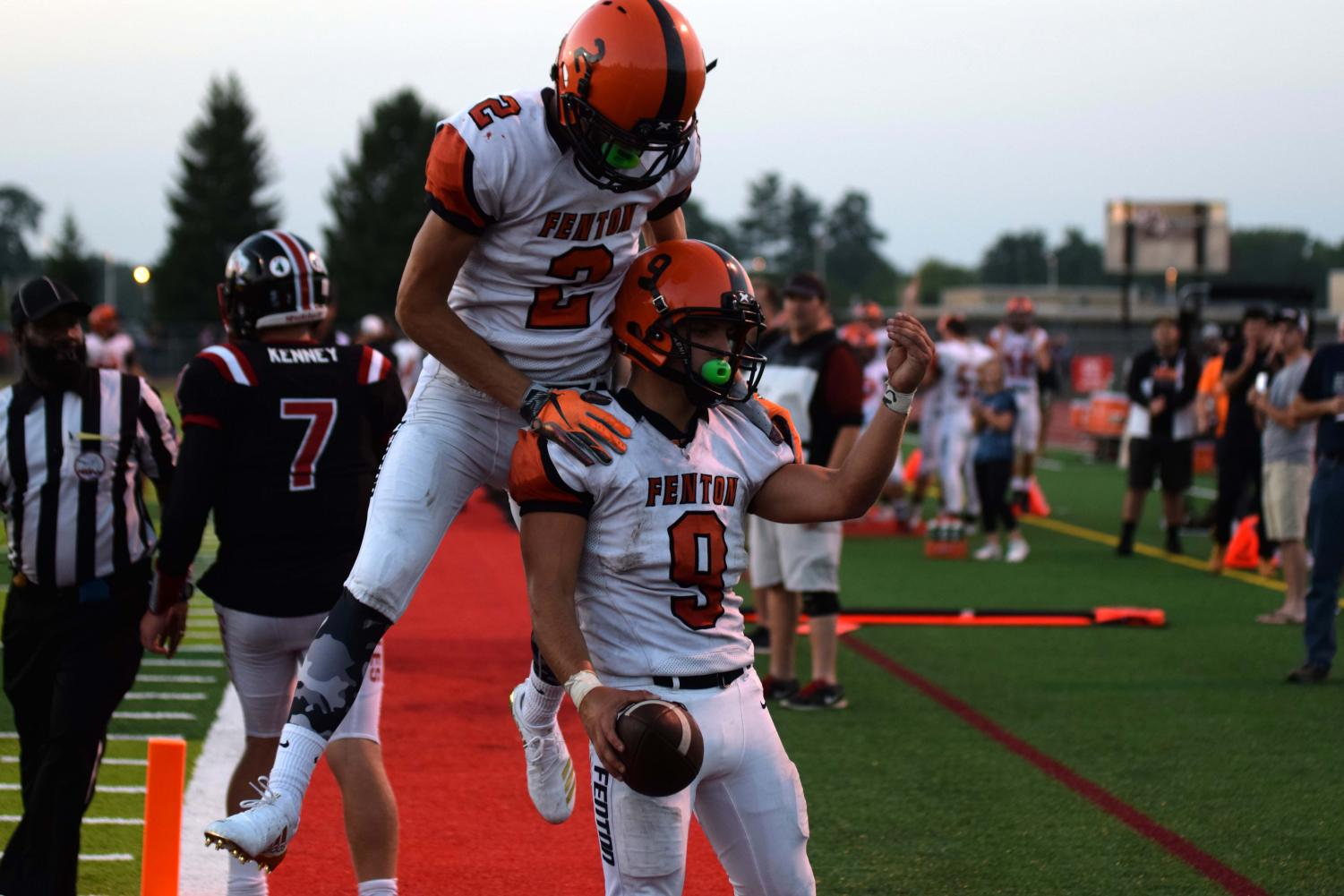 After scoring a touchdown, seniors Spencer Rivera and Cameron Steeves celebrate the six points on Linden. Rivera led the Tigers with multiple touchdowns to help them secure victory over the Linden Eagles, 34-7.