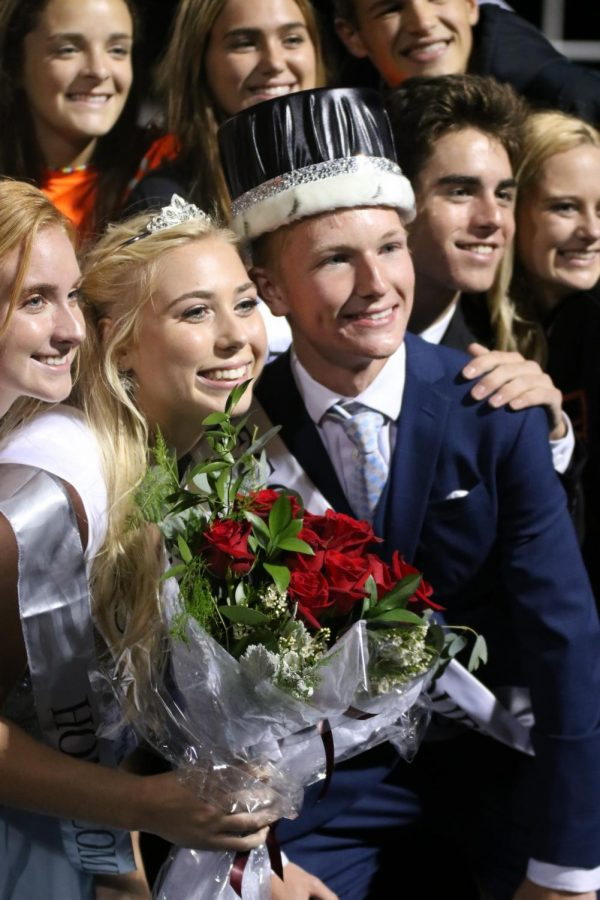 After seniors Chloe Idoni and Nolan Day were crowned king and queen they pose with friends for a picture. The king and queen were announced during the homecoming game on Sept. 21.