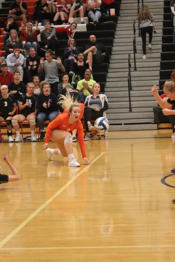 Leaping for the ball, senior Lauren Lamb dives for the ball. Fenton Varsity Volleyball played against Holly for the last home game of the season, on October 3rd, the Tigers defeated the Broncos.
