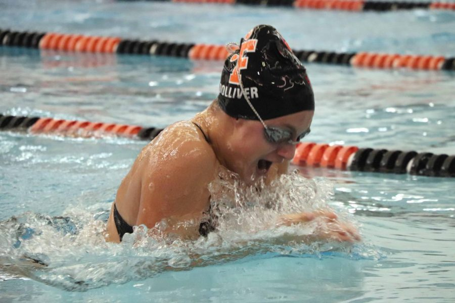 While coming up for air during her 100 yard breaststroke, sophomore Abby Dolliver takes the win against Grand Blanc High. The Fenton High girls swim team beat Grand Blanc 200-150.