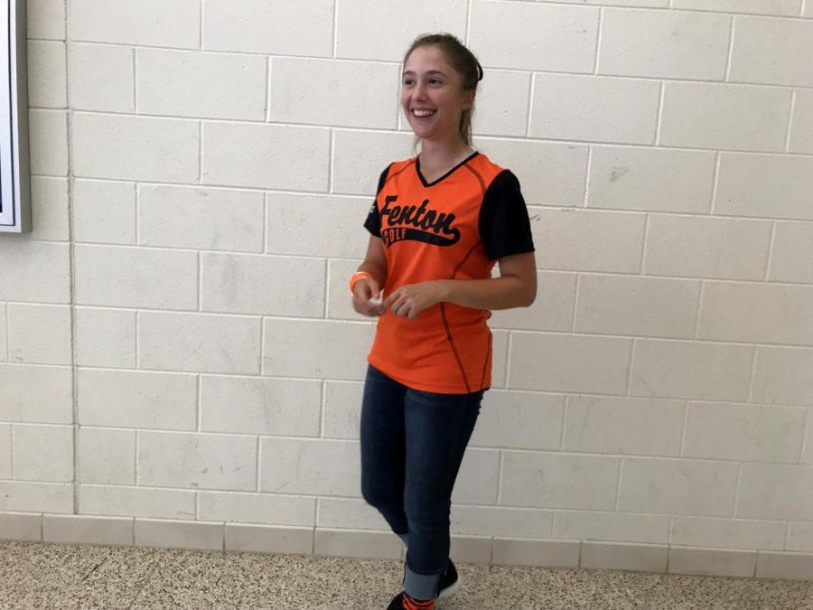 To pump up her school during Fenton spirit week, sophomore Olivia Herbert wears her striped socks and golf shirt.